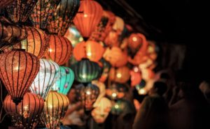 Array of multi-colored Chinese lanterns at night.